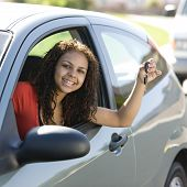foto of car key  - Teen driver inside car with keys smiles - JPG