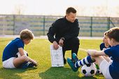 Football Coach Coaching Children. Soccer Football Training Session For Children. Young Coach Teachin poster