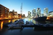 stock photo of canary  - Canary Wharf view from West India Millwall Docks - JPG