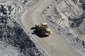 stock photo of dump-truck  - Truck at a pit mine in day light - JPG