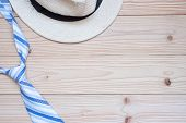 Blue Necktie And Hat On Wooden Background With Copy Space For Text. Happy Fathers Day And Internati poster