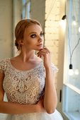 The Bride In A Lace Dress, With A Bunch. Restrained Elegance. Blonde. Looking Out The Window poster