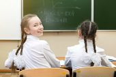 A Schoolgirl Teen Looked Back And Smiles At Her Classmate At School Girl Schoolgirl Looks Back Looki poster