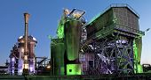 steel industry blast furnace factory or plant abandoned old industrial architecture at night with co