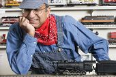 Man dressed as conductor in hobby shop