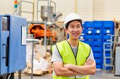 Front View Of Asian Factory Worker With Safety Hard Hat Posed Looking At Camera With Happy Smile In  poster