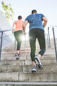 Hispanic Couple Running Or Jogging Together Outdoors. poster