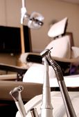 Dentist Drill And Tools And Dental Chair