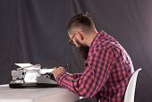 People, Writer And Hipster Concept - Young Stylish Writer Working On Typewriter poster