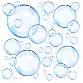 Transparent blue soap bubbles over white background