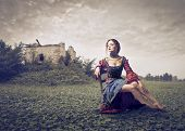 Renaissance woman on a lawn