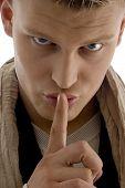 Young Man Asking To Keep Shushing