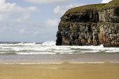 Atlantic Waves Crashing Onto Ballybunion Beach And Cliffs