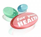 Three colorful vitamins or dietary supplements with the words For Your Health to represent healthy additions to balance your diet and eating regimen