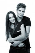 young couple, beautiful cheerful girl and boy, studio shot over white toned blue