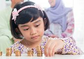 stock photo of southeast asian  - Muslim banking concept - JPG
