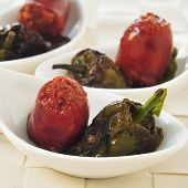 some little bowls with spanish fried chorizo and Padron peppers served as tapas