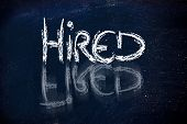 Hired Vs. Fired Message On Chalkboard