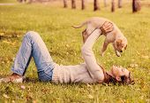 picture of caress  - Girl with her dog resting on grass - JPG