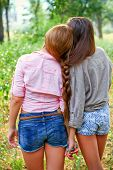 Two Girlfriends With A Pigtail Outdoors