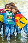 Cheerful middle school friends in rain gear