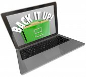 A laptop computer screen with a filing cabinet and the words Back It Up to illustrate a backup system for important documents and files
