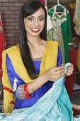 foto of dupatta  - Portrait of an Indian female dressmaker holding sari - JPG