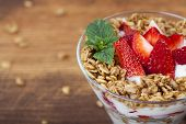 Fresh Strawberry and yogurt parfait with granola.