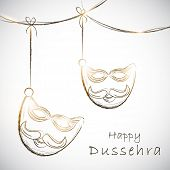 Indian festival Happy Dussehra concept with hanging mask of Ravana on abstract grey background.