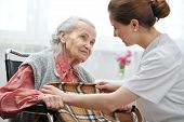 stock photo of hospice  - Female nurse is taking care of the senior woman - JPG