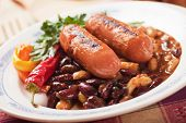 Grilled sausage with spicy chili beans and hot pepper