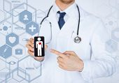 healthcare, medical and future technology concept - male doctor with stethoscope and virtual screen