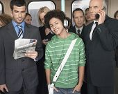 foto of commutator  - Commuters standing in train reading newspapers - JPG