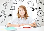 foto of little school girl  - education and school concept  - JPG