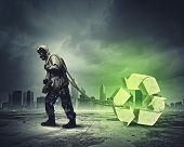 Man in respirator against catastrophe background. Recycle concept