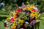 Close up of beautiful bouquets of flowers and herbs