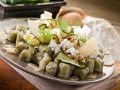 spinach gnocchi with ricotta zucchinis and parmesan flakes