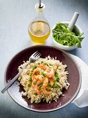 stock photo of pesto sauce  - brown rice with shrimp and arugula pesto - JPG