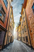 stock photo of cobblestone  - Colorful Alley with Cobblestone Prastgatan Stockholm  - JPG