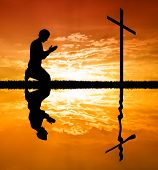 pic of eucharist  - illustration of a man praying under the cross with reflection - JPG