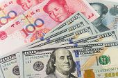 foto of yuan  - Background of US one hundred dollar and China Yuan notes - JPG
