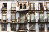 stock photo of derelict  - Old and derelict apartments in an urban area in Spain - JPG