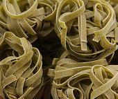 Italian green pasta tagliatelle.