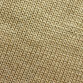 stock photo of tan lines  - a square background of tweed tan or camel colored knit fabric is braided in lines - JPG