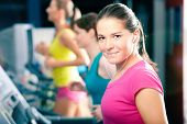 Running on treadmill in gym - group of women exercising to gain more fitness