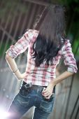 Young Woman With Guns Backside View