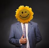 Smiling Sunflower Head Man In Suit Coat With Present Thumbs Up