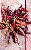 Dried Red Hot Chilli Pepper On Dark Vintage Wooden Background