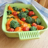casserole with broccoli,cherry tomatoes and carrots