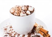 Hot Dark Chocolate With Mini Marshmallow  And Cinnamon In A White Cup, Closeup